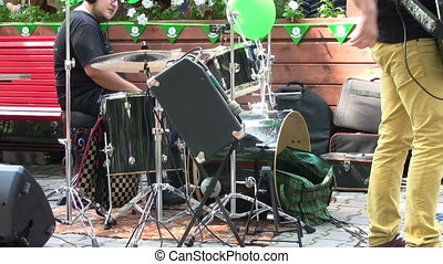 Drummer performing during a live concert outdoors