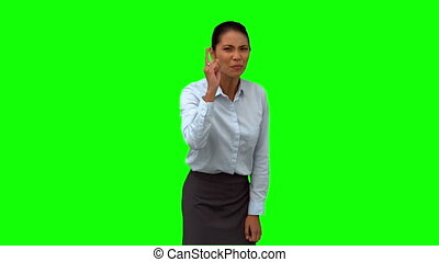 Angry businesswoman pointing on green screen in slow motion