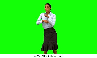 Businesswoman disco dancing on green screen in slow motion