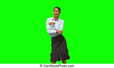 Cheerful businesswoman disco dancing on green screen in slow...