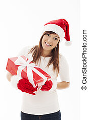 Beautiful woman with santa hat holding christmas present