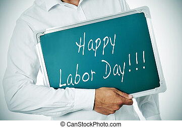 happy labor day - a man holding a chalkboard with the...