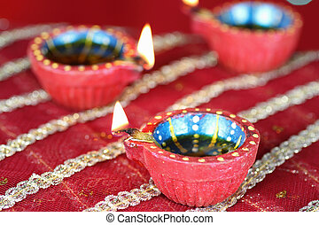 Diwali Diya with blurred lights in the background