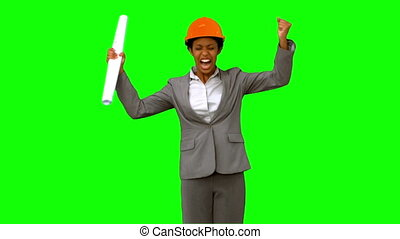 Happy architect raising arms on green screen in slow motion
