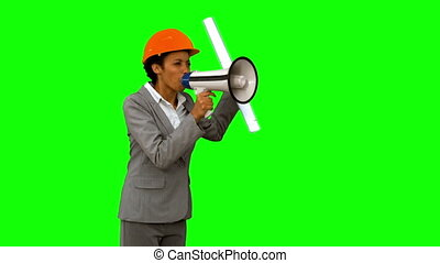 Angry architect using a megaphone on green screen in slow...