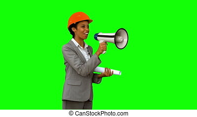 Happy architect using a megaphone on green screen in slow...