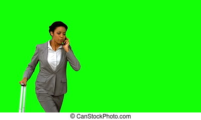 Late woman throwing her phone on green screen in slow motion