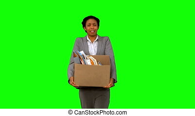 Fired businesswoman dropping a box on green screen in slow...