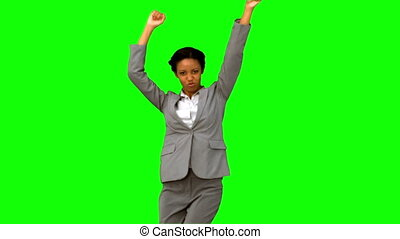 Cheerful businesswoman dancing on green screen in slow...