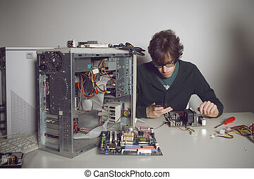 Computer Repair: young man using cellphone