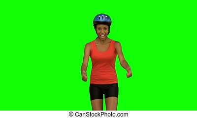 Cyclist woman giving thumbs up on green screen in slow...