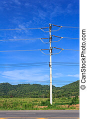 Electric pole on a blue sky background