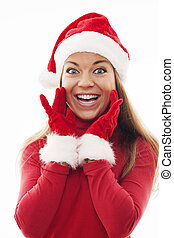 Young woman with santa hat and gloves looking excited