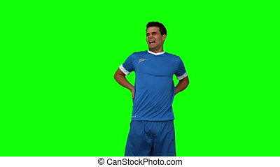 Football player calling doctors on green screen in slow...