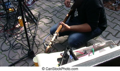 Bass guitarist playing at live rock concert