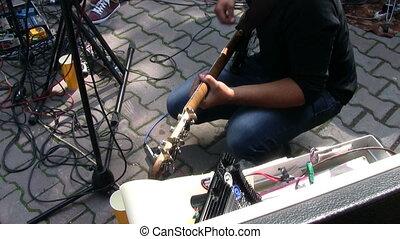 Bass guitarist playing at live rock