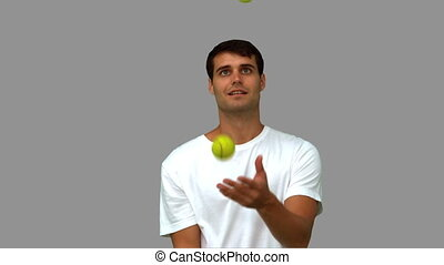 Man juggling with tennis balls - Man dribbling with tennis...
