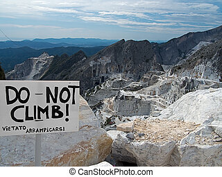 Carrara marble quarries view and sign - No climbing