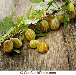 Gooseberries On Wooden Surface,Close Up
