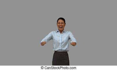 Happy businesswoman gesturing