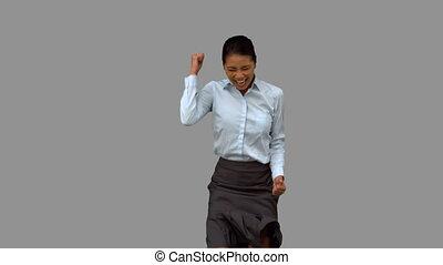 Cheerful businesswoman gesturing