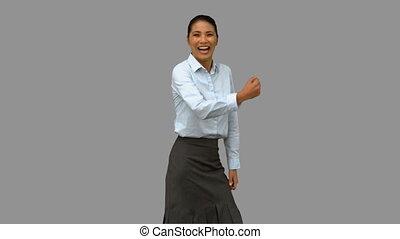 Pretty businesswoman gesturing