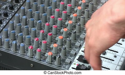 Sound engineer working on mixer at live concert
