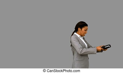 Angry businesswoman throwing her agenda on grey screen in...
