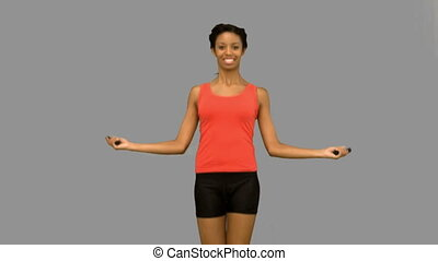 Cheerful woman working out with a r