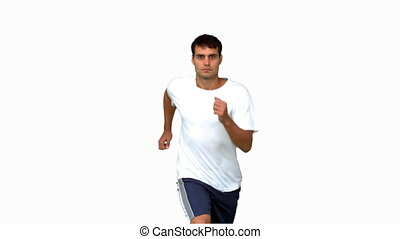 Handsome man jogging on white screen in slow motion