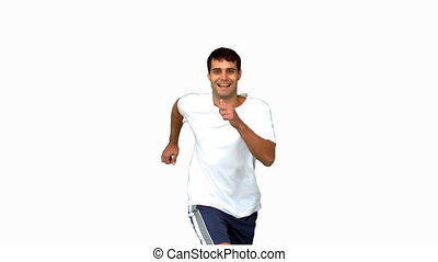 Cheerful man jogging on white screen in slow motion