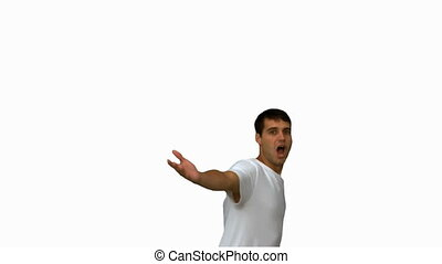 Handsome man turning and raising arms on white screen in...