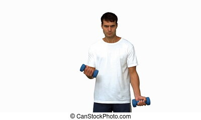 Handsome man lifting dumbbells on white screen in slow...
