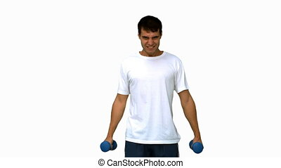 Attractive man lifting dumbbells on white screen in slow...