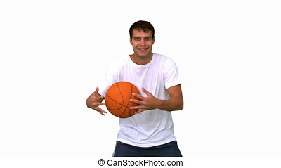 Man playing and dribbling with a basketball on white screen...