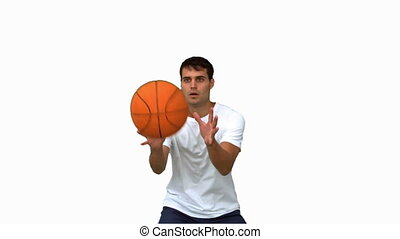 Man catching and throwing a basketball on white screen in...