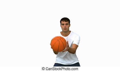 Handsome man catching and throwing a basketball on white...