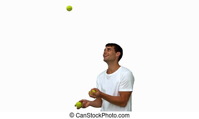 Man dribbling with balls on white screen in slow motion
