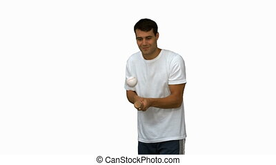 Man dribbling with a baseball on white screen in slow motion