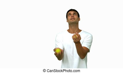 Handsome man dribbling with balls on white screen in slow...