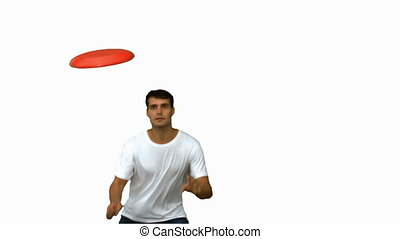 Man jumping and catching a frisbee on white screen in slow...