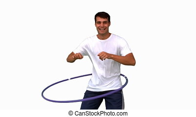 Man playing with a hula hoop on white screen in slow motion