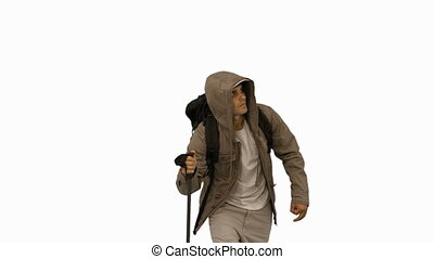 Attractive man with a coat trekking on white screen in slow...