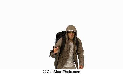 Man with a coat and a hiking stick running on white screen...
