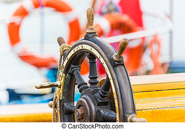 Steering wheel on sailing ship - Macro view of wooden...
