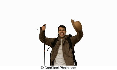 Happy man throwing his hat on white screen in slow motion