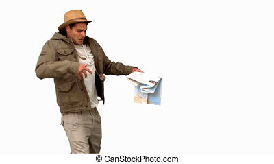 Handsome man orienteering on white screen in slow motion