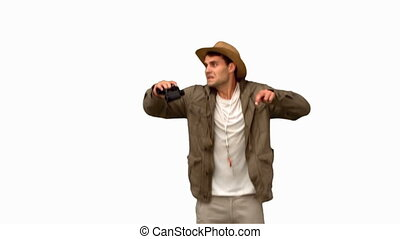 Man jumping and using binoculars on white screen in slow...