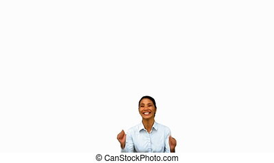 Cheerful businesswoman raising arms on white screen in slow...