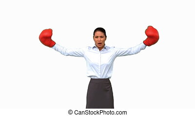 Businesswoman gesturing with boxing gloves on white screen...